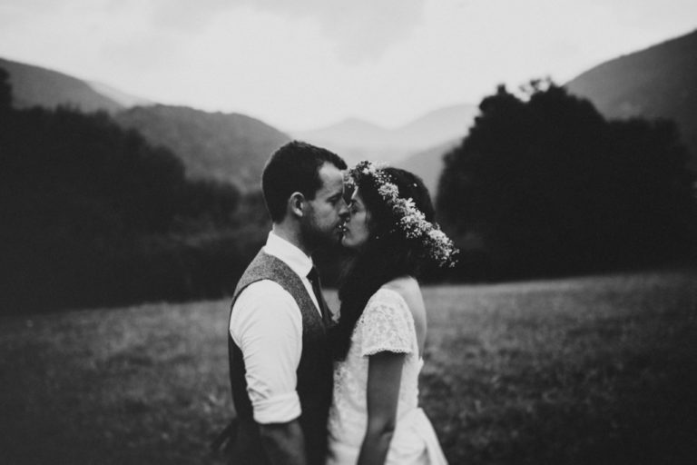 Couple in love surrounded by the Pyrenees mountains in summer