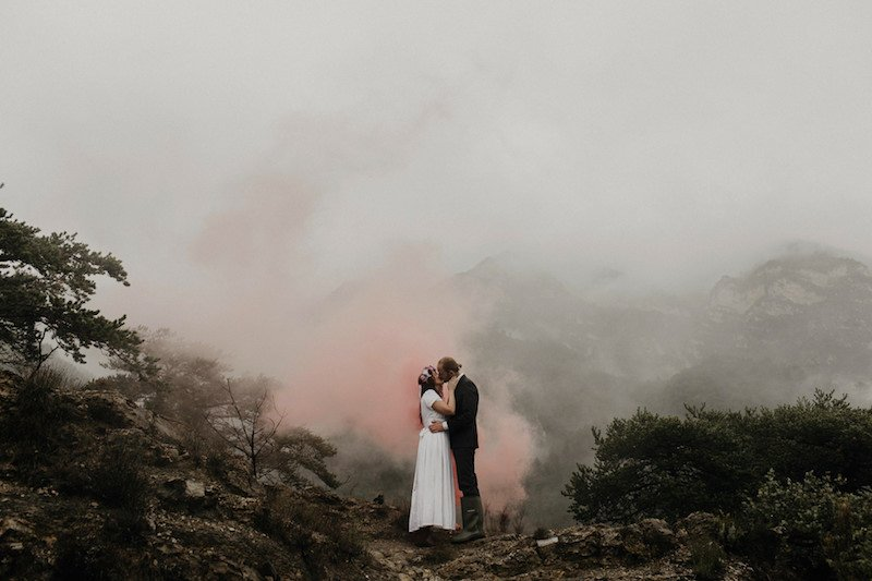 Married couple in the French Alps with fog