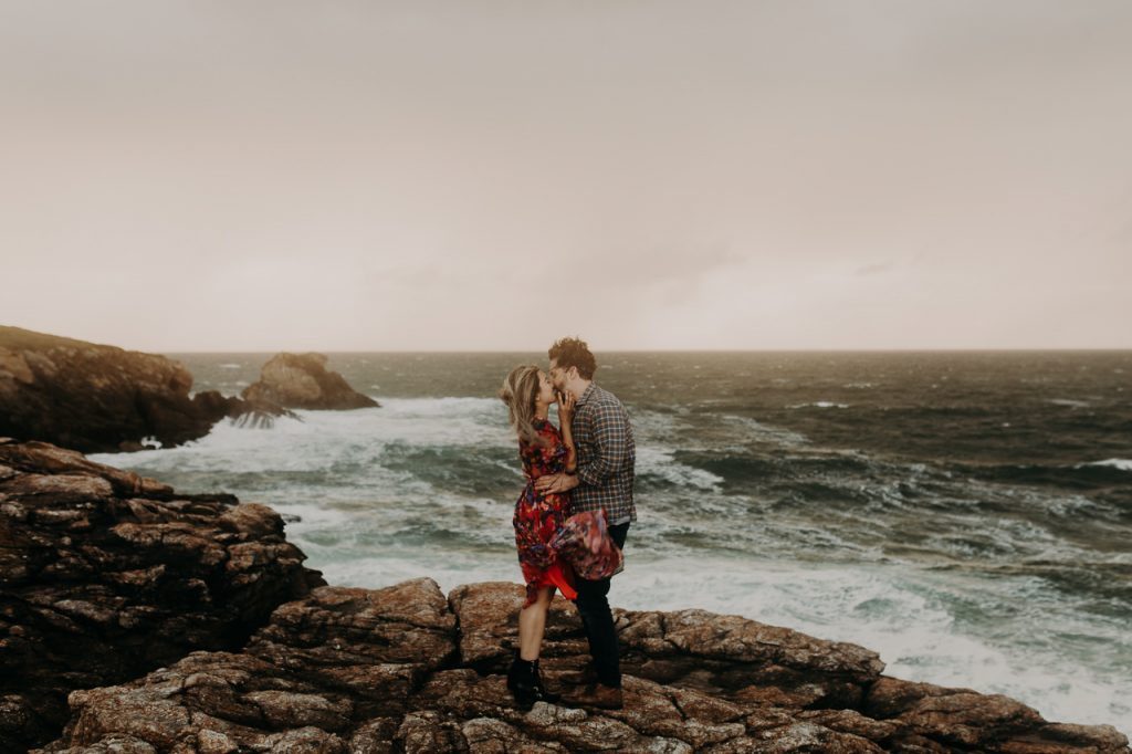 A couple in love on the windy seaside