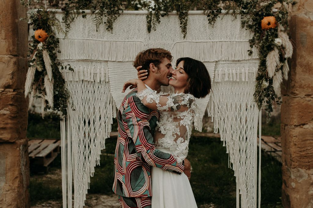 bride and groom kissing during their outdoor intimate ceremony